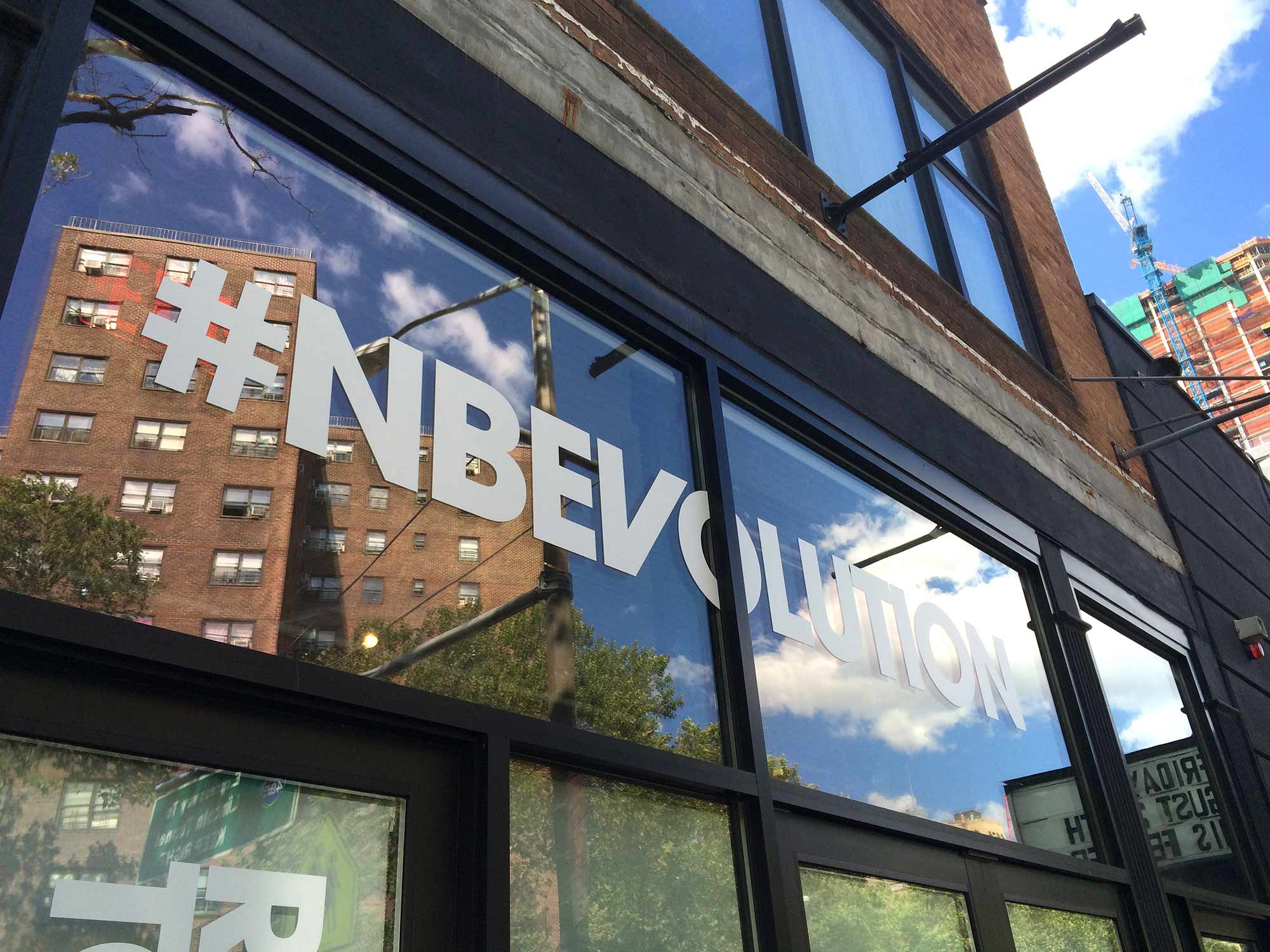 Guests were greeted with boldly branded windows at the New Balance #NBEvolution Press Event.