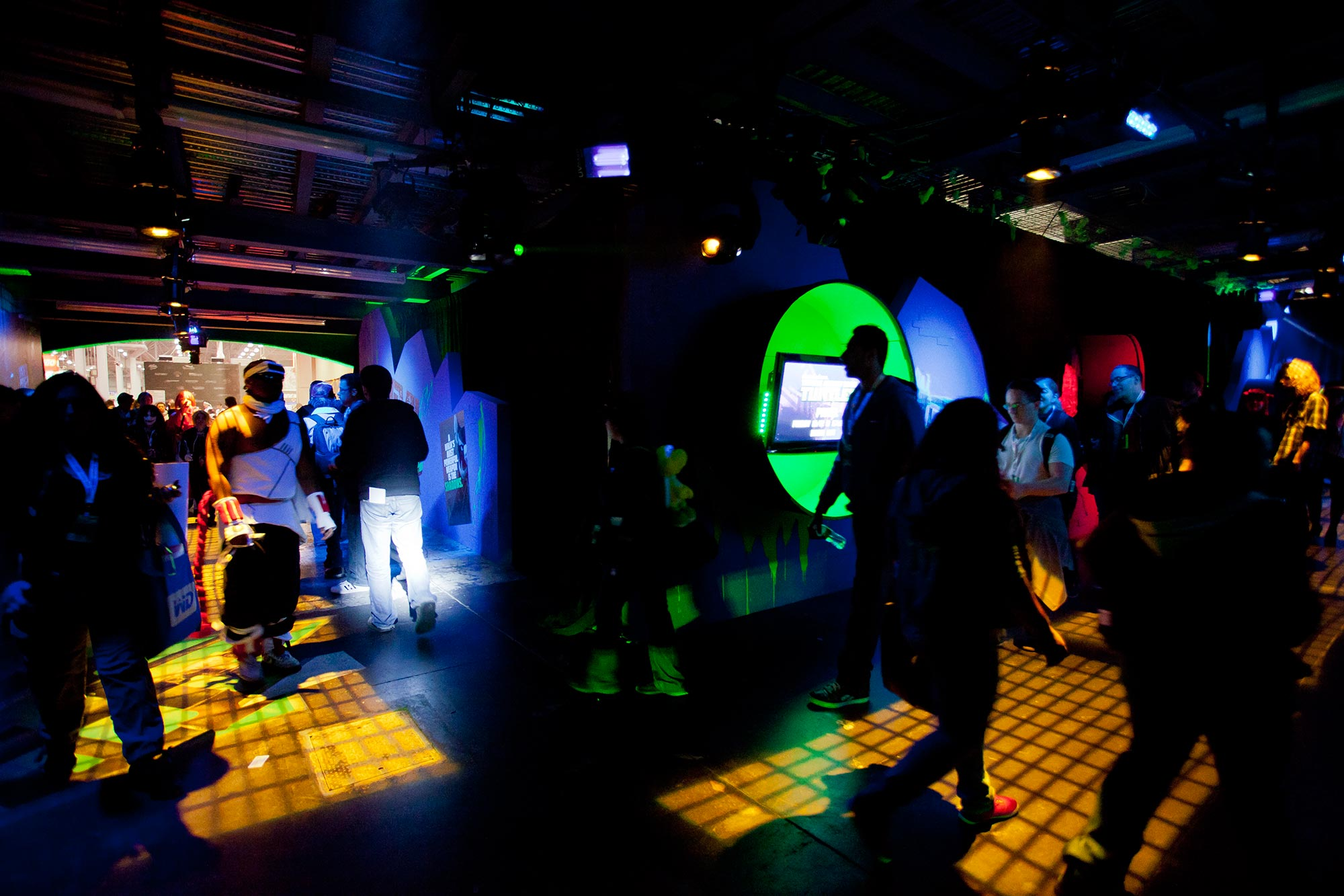 Guests in the TMNT hallway enjoy exclusive content from the Nickelodeon show by peering into sewer tubes.