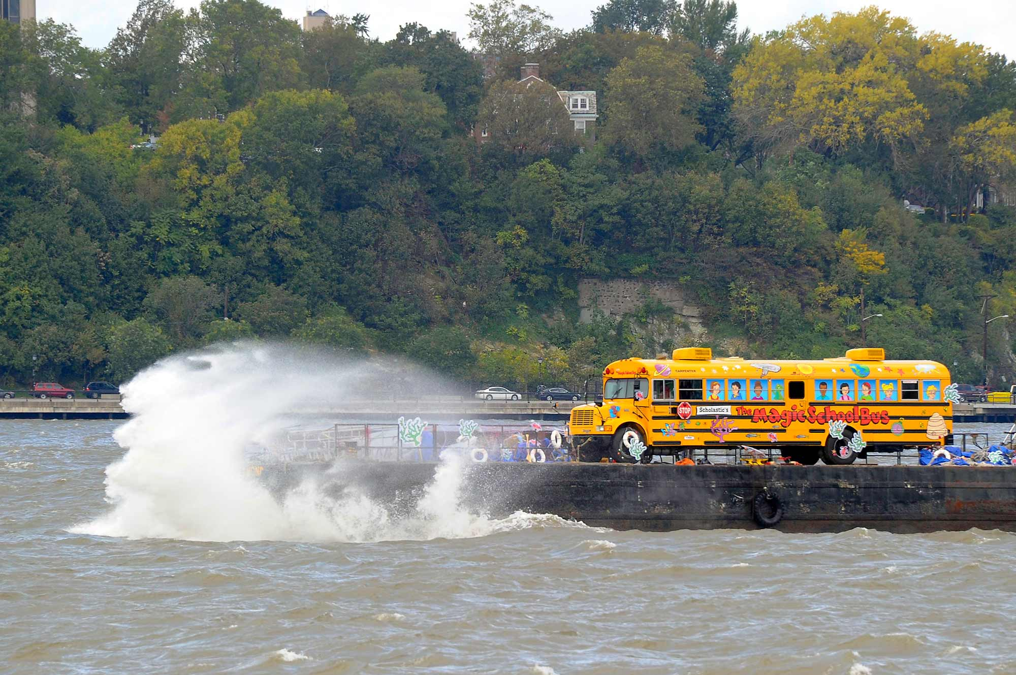 The Magic School Bus rides along the Hudson toward Pier 84.