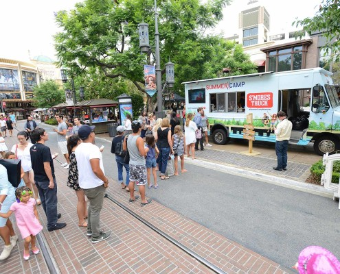 Guests line up to order their own gourmet s'more from the Summer Camp S'mores Truck, promoting the USA network's reality competition series.